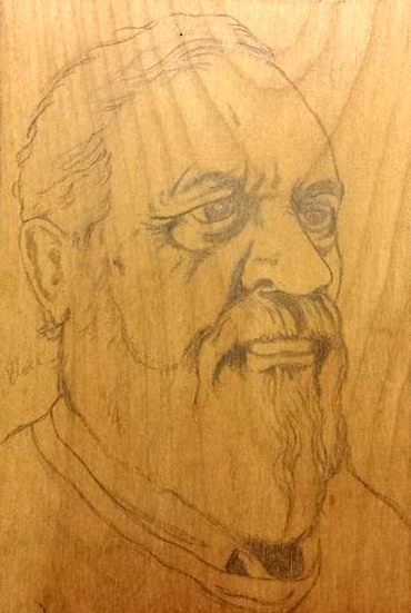 Wood block with pencil self portrait ready for woodcut