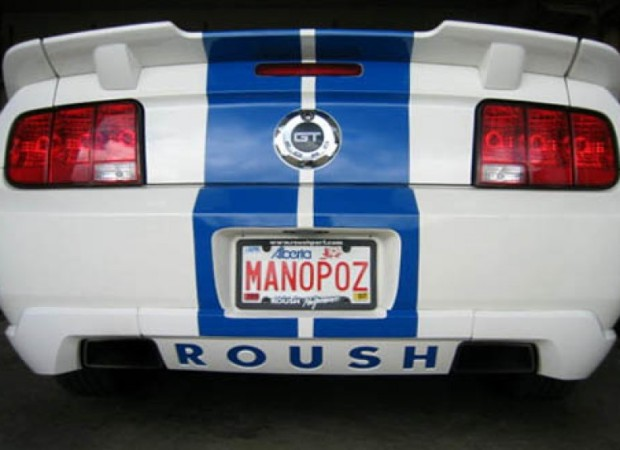 "License plate on sports car reads ""MANOPOZ"""