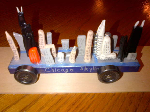 Photo of Pinewood Derby care modeled to look like the Chicago skyline.