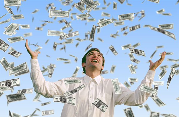 Man is happy as thousands of dollars in cash rains down on him as if from Heaven.